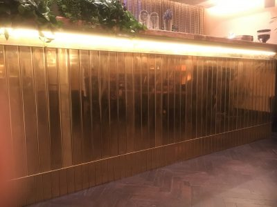 Brass Metal Polishing Repair | The front face of the bar shows different levels of finish