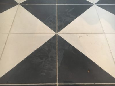 Cement Tiles Stain Removal Clean | The white etch stain can be seen clearly on the dark section of the floor.