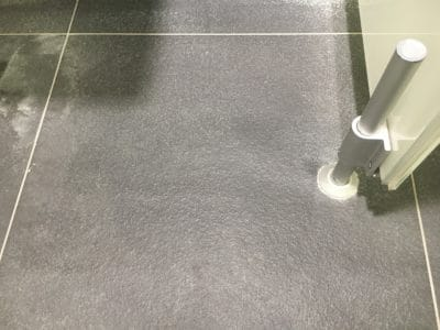 Ceramic Floor Tile Crack Repair | Wider angle view of the same tile shows no cracks at all