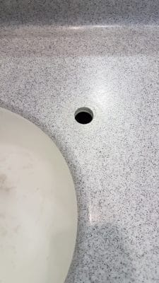 Corian Repairs To Mask Tap Holes | 25mm hole in Corian is unsightly