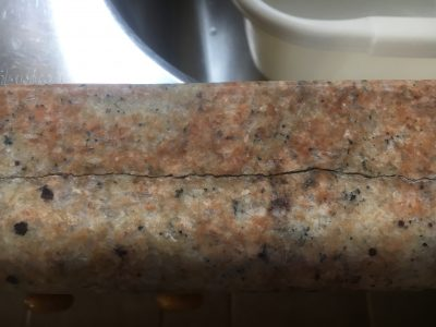Cracked Granite Kitchen Worktop Repair | The crack is open and dirty