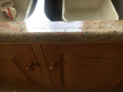 Cracked Granite Kitchen Worktop Repair | The crack can be seen from further away in the reflection