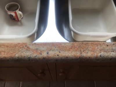Cracked Granite Kitchen Worktop Repair | The crack has been cleaned and filled with stone fillers