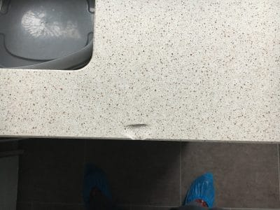 Engineered Quartz Kitchen Worktop Edge Chip Repair | Close up to the sink, the deep chip is very obvious