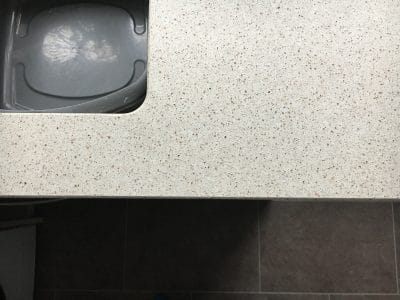 Engineered Quartz Kitchen Worktop Edge Chip Repair | Close up to the sink it is extremely hard to see any sign of damage or repairs