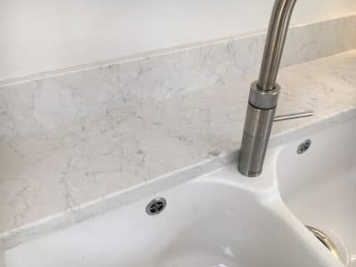 Engineered Quartz Stone Worktop Tap Hole Repair | A wider view after the repair shows no indication of the previous hole in the stone
