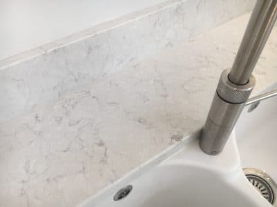 Engineered Quartz Stone Worktop Tap Hole Repair | Close up view after the repair, no one would suspect there was ever a hole behind the tap