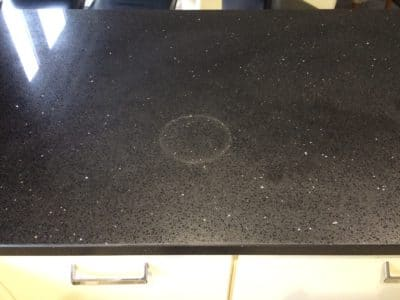 Engineered Stone Quartz Repair Heat Stain Treatment | The ring stain can be seen clearly from anywhere in the kitchen