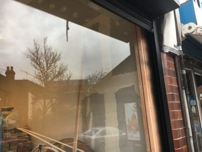 Glass Shop Front Scratch Graffiti Removal And Polishing | After the polishing repair there is no evidence of the past problem at all