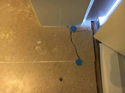Marble Floor Tile Crack Repair | View of broken tile near the door frame