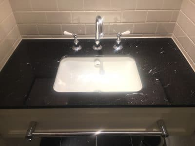 Marble Polishing To Nero Marquina Vanity Unit | Wide view of the previously stained vanity top