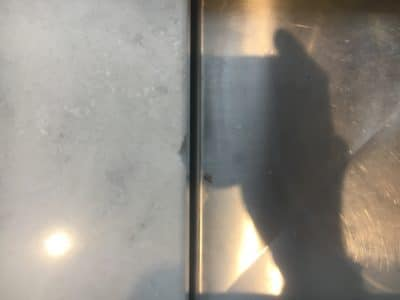 Quartz Broken Edge Chip Repair | A top view of the chipped edge