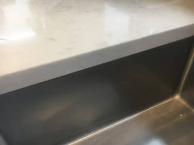 Quartz Broken Edge Chip Repair | The edge seems brand new with no sign of the damage