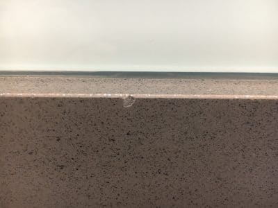 Quartz Kitchen Top Chip Repair | Edge chip is very obvious under the glass splashback