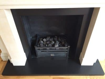 Slate Hearth | Overview of the fireplace after the repairs and treatment shows a perfect slate finish as it should be.