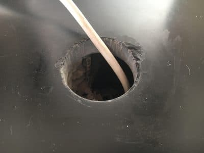 Slate Hearth Chip Repair On Led Fitting | Close up of the drill hole and the broken edge.