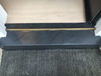 Slate Threshold | view of the same threshold piece after some polishing and treatment to protect the stone.