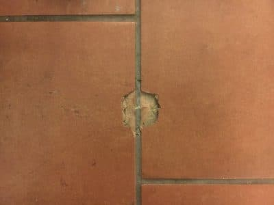 Terracota Clay Tile Repair | A close up of the damage to the tiles