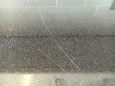 African Black Granite Worktop Scratch Repair | Close up of the worst scratches.
