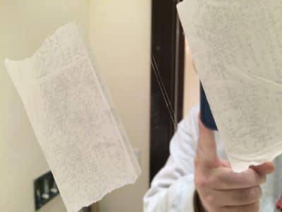 Bathroom Mirror Deep Scratch Removal | The scratch on the mirror is very clear between the tape marks.