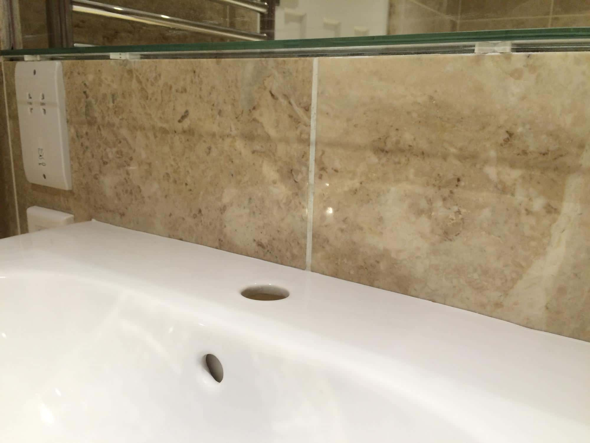 Bathroom wall tile stain removal | Bespoke Repairs
