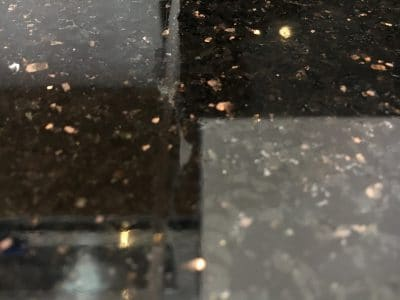 Black Granite Kitchen Top Crack Repair | Joint line up close.