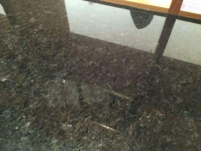 Black Granite Scratch Removal And Polishing | Polishing is completed to reveal new shiny and scratch free surface.