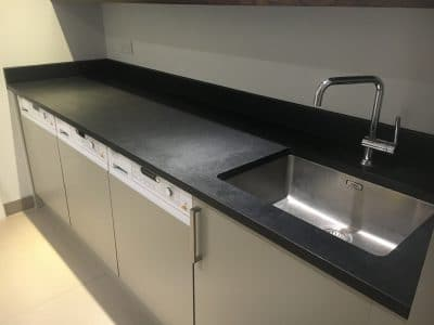 Black Granite Worktop Detergent Stain Removal | General view as you open the door to the utility room shows the blemishes to the worktop.