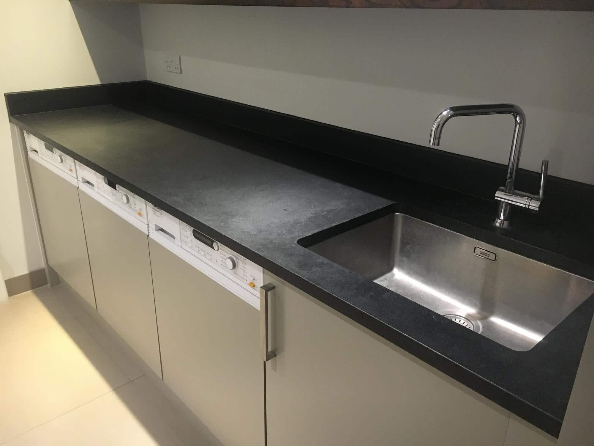 Black granite detergent stain removal | Bespoke Repairs