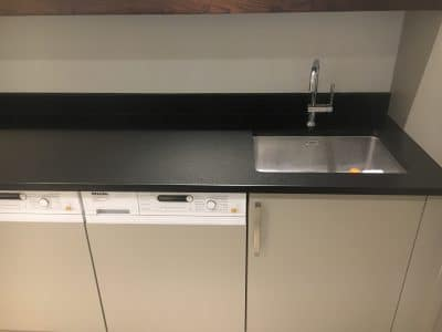 Black Granite Worktop Detergent Stain Removal | After the polishing and protection the stone is as good as new.