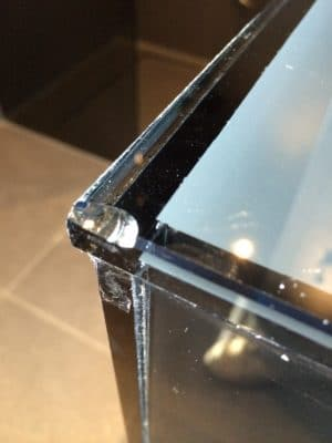 Bonded Glass Cabinet Broken Edge Repair | The due of the vanity unit was chipped and left sharp and dangerous to anyone using the room.