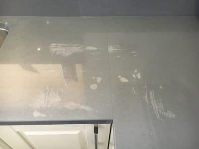 Engineered Stone Kitchen Top Stain Removal | Close up of the main damaged area of the worktop shows obvious stains.