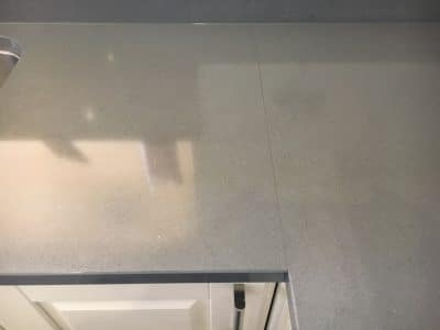 Engineered Stone Kitchen Top Stain Removal | Original view of the previously damaged area shows no stains at all.