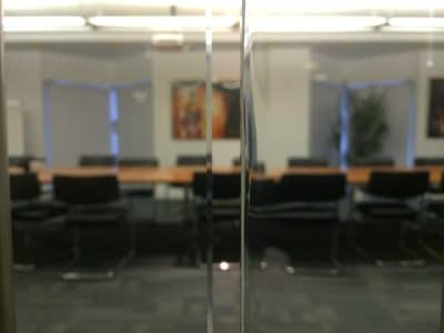 Glass Door With Large Chip Right Side Repair | After the edge repair and polishing the chipped look is gone and the glass is smooth and safe to touch.
