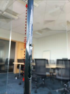 Glass Office Door Large Mm Edge Chip Repair | The edge chip occurred after a metal chair hit the edge of the glass leaving a sharp ugly edge.