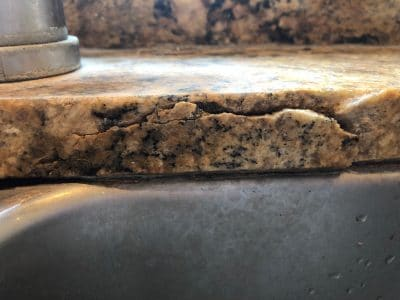 Granite Break Edge Repair Scaled | Profile view of the break