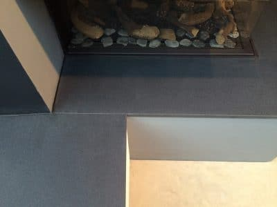 Granite Fireplace Oil Wax Stain Removal | After the polishing and cleaning the stone is back to original look.