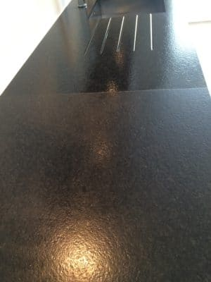 Granite Kitchen Surface Stain Clean St Edwards | The image shows the kitchen half way through the cleaning and treatment procedure.