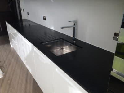 Granite Kitchen Surface Stain Clean St Edwards | After the repair the kitchen top looks clean and dark in colour.