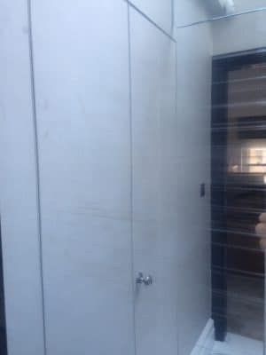High Shine Stainless Steel Lift Door Polising | Door looks scratched and worn.