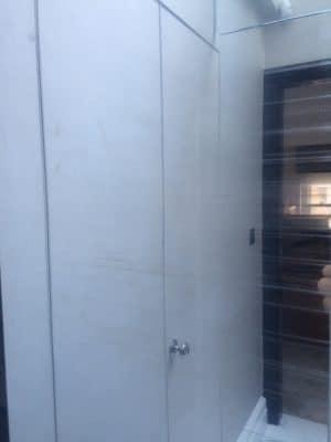 High Shine Stainless Steel Lift Door Polising | Door looks scratched and worn.