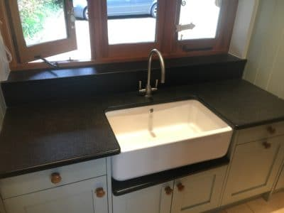 Kitchen Black Granite Surfaces Clean And Treatment | View of the same stone after cleaning and treatment in the utility room shows no signs of staining.