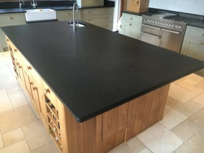 Kitchen Black Granite Surfaces Clean And Treatment | The kitchen island looks clean and in a uniform dark colour after the treatment, bringing the original colour of the stone back to the kitchen.