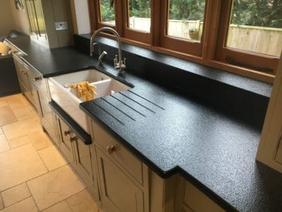 Kitchen Black Granite Surfaces Clean And Treatment | Another angle of the kitchen worktop after the repairs.