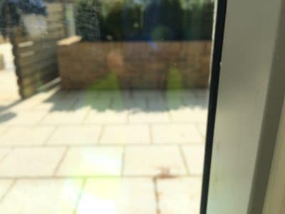 Laminate Glass In House Impact Chip Repair | Wide angle view shows no evidence of the previous damage and looks completely repaired.