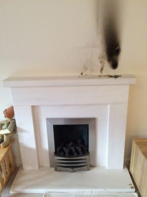 Lime Stone Fireplace Mantle Burn Wax Stain Removal | Overview of the fireplace before work begins.