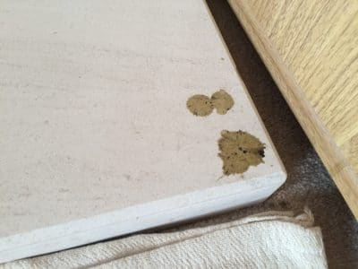 Lime Stone Fireplace Mantle Burn Wax Stain Removal | Hearth shows wax stains from the wax drips.