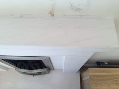 Lime Stone Fireplace Mantle Burn Wax Stain Removal | The mantle piece is as good as new, clean and polished with no evidence of the accident at all. The wall was cleaned but needs redecorating.