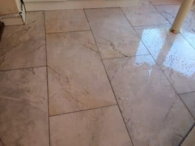 Marble Floor Humidity Stain Removal | After the treatment sessions, the floor is washed with special cleaners.