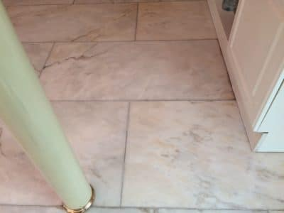 Marble Floor Humidity Stain Removal | The dark brown stains near the cupboard are gone and the stone is back to its original colour.